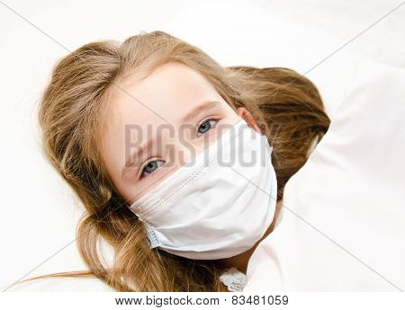 Sick Little Girl With Surgical Face Mask For Bacterial And Virus Flu Protection