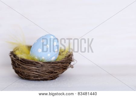 One Blue Easter Egg In Nest With Coppy Space