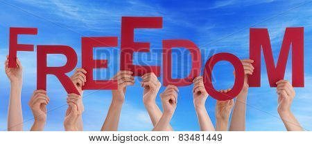 Many People Hands Holding Red Word Freedom Blue Sky