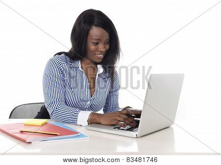 Black African American Ethnicity Woman Working At Computer Laptop At Office Desk Smiling Happy