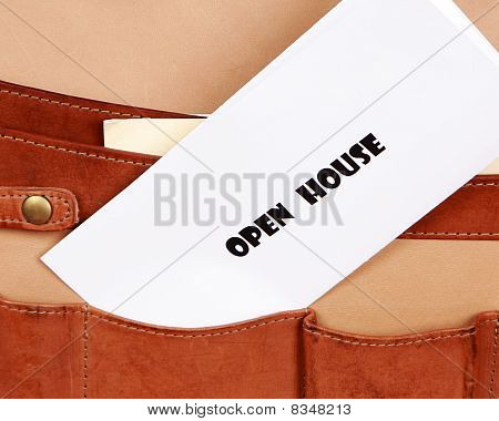 OPEN HOUSE document in briefcase