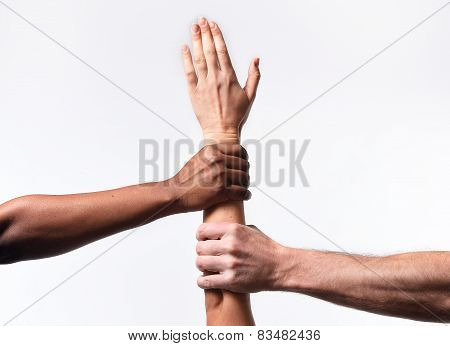 Black African American And Caucasian Hands Holding White Skin Arm In World Unity