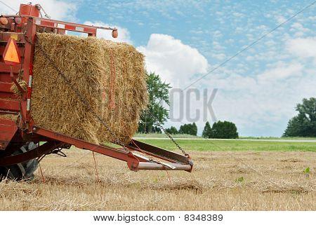 closeup of a hay baler