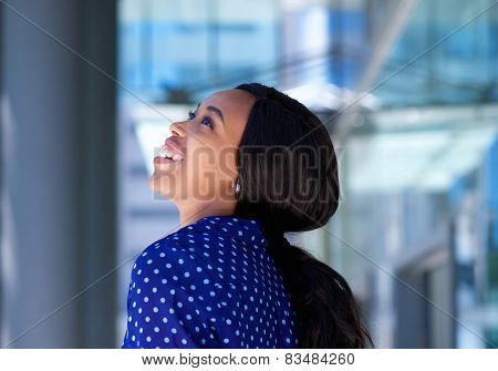 Cheerful Young Black Business Woman Laughing Outdoors