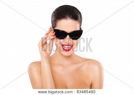 Beautiful fashion model girl with stylish oversized black sunglasses. Isolated on white background.