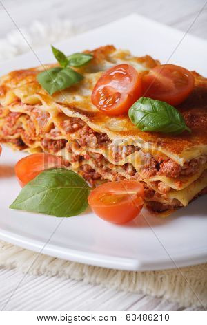 Portion Of Italian Lasagna On A White Plate. Vertical