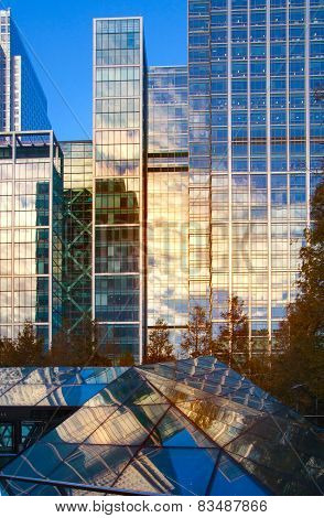 LONDON, UK - NOVEMBER 29, 2014: Canary Wharf modern glass architecture of famous office buildings