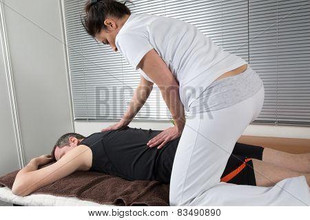 Man And Woman Performing Back Shiatsu Massage