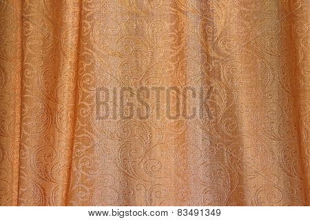 Texture Of Gold Fabric With Pleats And Abstract Ornament