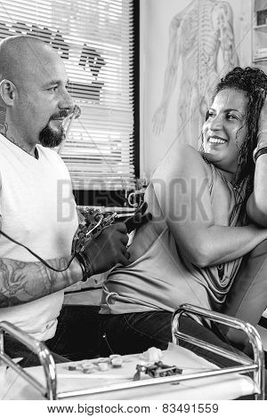 Tattoo Artist And Customer.
