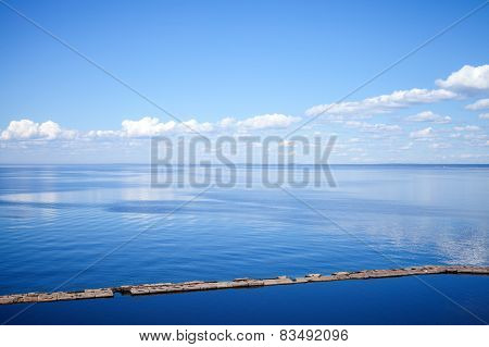 Seascape With Old Concrete Breakwater And Cloudy Sky
