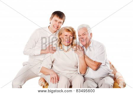 Happy smiling senior couple with son. Isolated on white background.