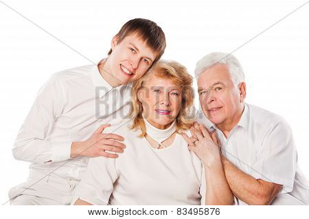 Happy senior couple with son. Isolated on white background.