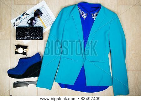 Outfit of clothes and woman accessories. Overhead of essentials business woman.