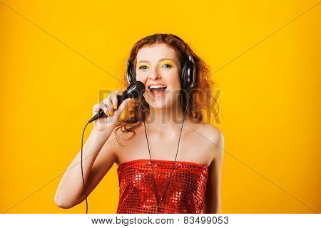 Young woman with microphone. Singer. Karaoke