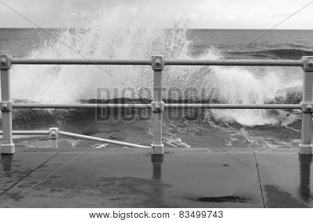 Railing and wave a