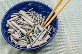 stock photo of disgusting  - Screws and dowels ready to be eaten in a bowl - JPG