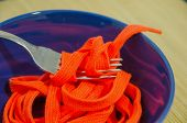 foto of disgusting  - A fork with a shoestring in a blue bowl - JPG