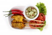 pic of malaysian food  - Grilled pork satay with sauce on plate Thai Food - JPG