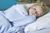 stock photo of sick  - A sick little boy in a hospital bed - JPG