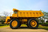 picture of mines  - Heavy mining truck in mine and driving along the opencast - JPG