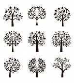 stock photo of tree leaves  - Set of different trees silhouette with roots and branches for logo - JPG