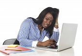 stock photo of frustrated  - black African American ethnicity tired and frustrated woman working as secretary in stress at work office desk with computer laptop desperate in business frustration concept - JPG