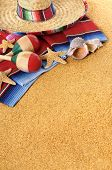 stock photo of mexican fiesta  - Mexican beach background with sombrero straw hat traditional serape blanket starfish seashells and maracas - JPG
