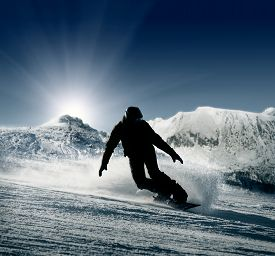 picture of snowboarding  - Snowboarder silhouette on the snow hills view - JPG