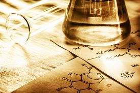 stock photo of chemical reaction  - Chemistry with reaction formula in toning in closeup - JPG