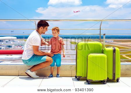 Father And Son Ready For Summer Vacation, While Waiting For Boarding In International Airport