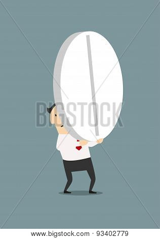 Businessman carrying a big pill