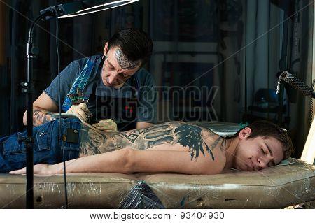 Tattoo Artist Draw Tattoo In Studio