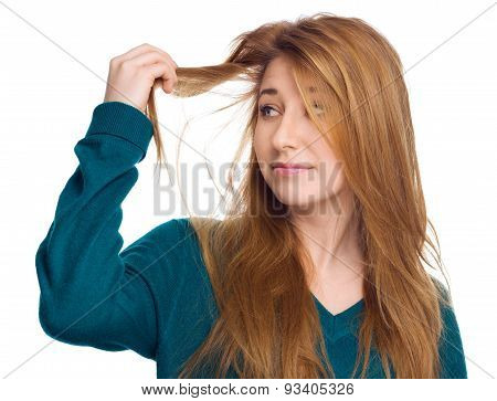 Young Woman Holding Damaged Long Hair The Hand And Looking At Split Ends, Isolated On White.