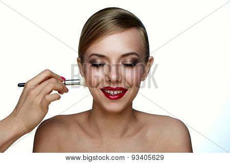 Makeup Artist Applying Powder Foundation With Brush.