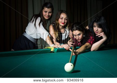 Four Young Women Have Fun With Playing Billiard