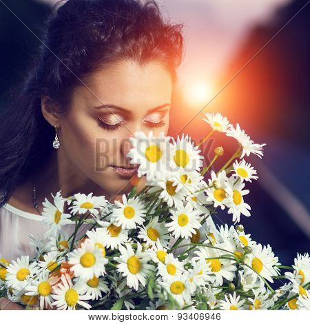 Toned Image Of Young Beautiful Dreamy Women With Bouquet Of Flowers.