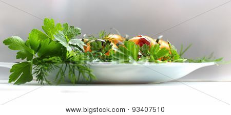 salad of tomato, parsley and celery on the plate