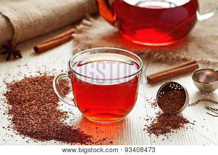 Healthy traditional herbal rooibos beverage tea with spices on vintage table