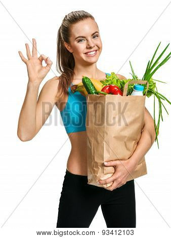 Happy Smiling Athletic Woman Showing Okay Gesture With Grocery Bag Full Of Healthy Fruits And Veg
