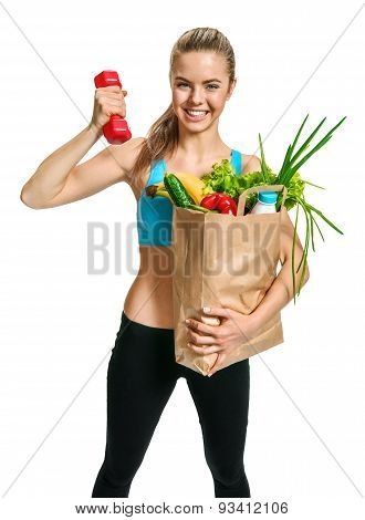 Happy Cutie Athletic Woman Showing Biceps With Grocery Bag Full Of Healthy Fruits And Vegetables