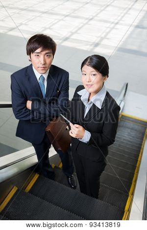 Business Team On The Escalator