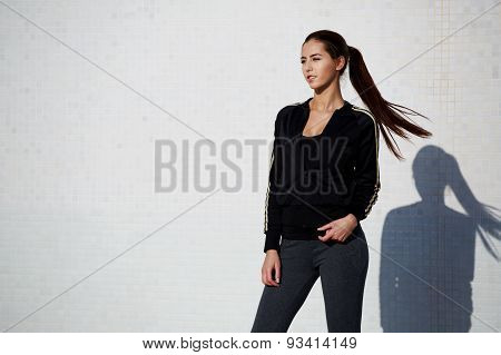 Attractive young woman standing on white background at beautiful sunny day