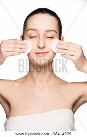 skin care woman removing face with cotton swabs