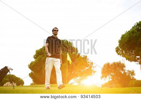 Portrait of professional golf player walking to the next hole on beautiful course good golf game