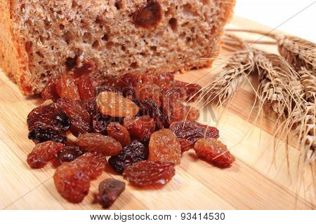 Baked Wholemeal Bread, Raisins And Ears Of Wheat