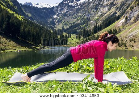 Woman In Plank Pose Outdoors