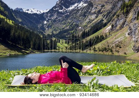 Woman In Relaxation Pose In Yoga Outdoors