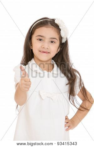 Charming dark-haired little girl thrust out his hand with a rais