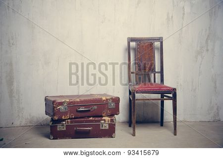 two old suitcases and the chair